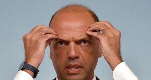 Il ministro dell'Interno Angelino Alfano durante la conferenza stampa al termine del Consiglio dei ministri, Roma, 27 agosto 2015. ANSA/ETTORE FERRARI